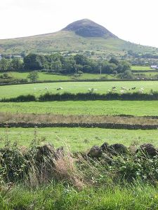 Slemish, mountain in County Antrim where St Patrick is reputed to have shepherded as a slave Photo: Man vyi Wikimedia commons