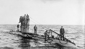 The crew of a German UC-1 class submarine on deck.  wikimedia commons
