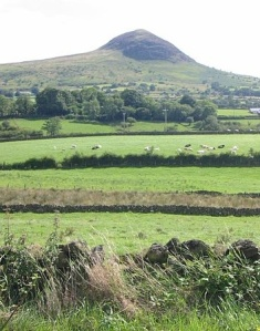 Slemish mountain, County Antrim where, it is told, St Patrick worked as a shepherd while a slave Photo:  Man vyi  Wikimedia Commons
