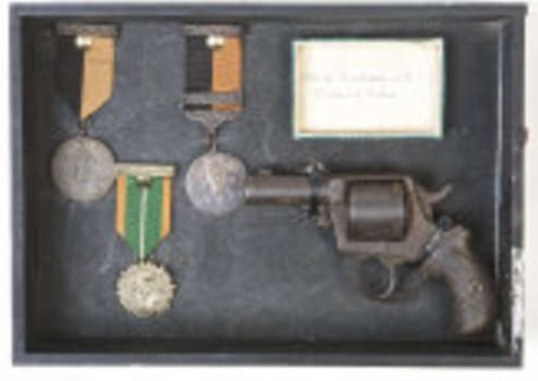 Kinvara 1916 and War of Independence Medals awarded to brother and sister, Joe and Annie Kilkelly, Kinvara, Co. Galway and revolver owned by Joe Kilkelly.   Image:  Adams.ie